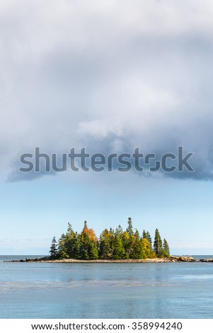 Small Island with Storm Clouds in Autumn