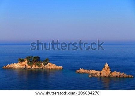 Small islands surrounded by Mediterranean sea at sunrise - stock photo
