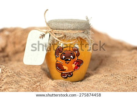small jar of honey with a note - stock photo