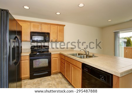 Small kitchen with tile floor and nice sink. - stock photo