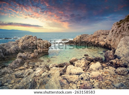 Small lagoon in the cape Milazzo, nature reserve Piscina di Venere, Sicily, Italy, Tyrrhenian sea, Europe. Colorful spring sunset.