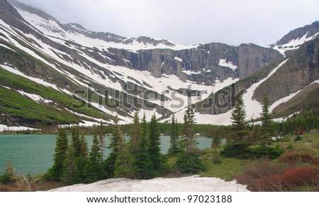 Small lake in Glacier National Park - stock photo