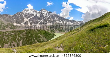 Small lake in the mountains of the Caucasus. - stock photo