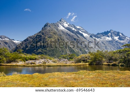 Small lake on a top of the summit - stock photo