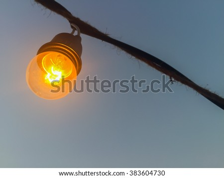 small light bulb switch on in the night.
