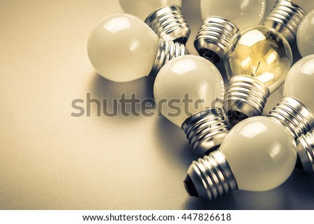 Small light bulbs and the different one glowing in the group, small business, original idea concept - stock photo