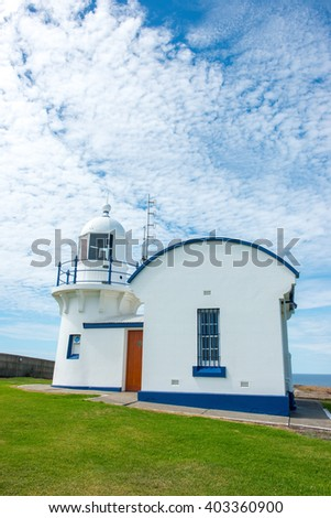 Small light house with blue sky