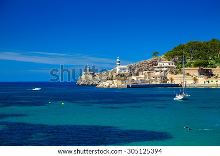 small lighthouse at the pier of Port de Soller, Majorca, Spain - stock photo