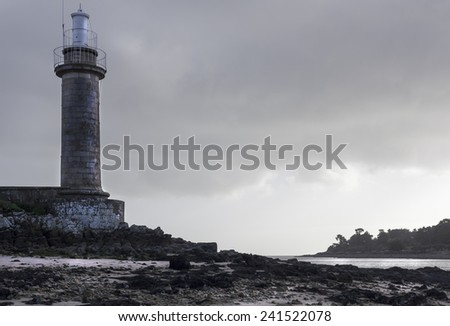 Small lighthouse in france on a dark stormy day