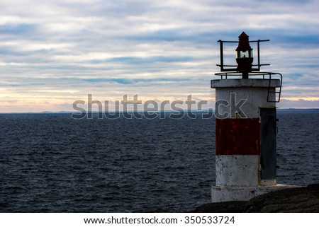 Small lighthouse in sunset by the Baltic sea in sweden - stock photo