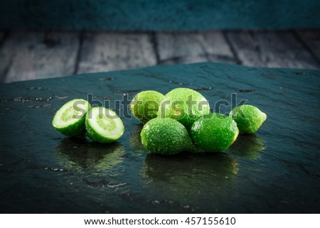 Small limes citrus fruit unripe, intense green - stock photo