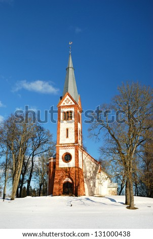 Small lutheran church in latvia in winter - stock photo