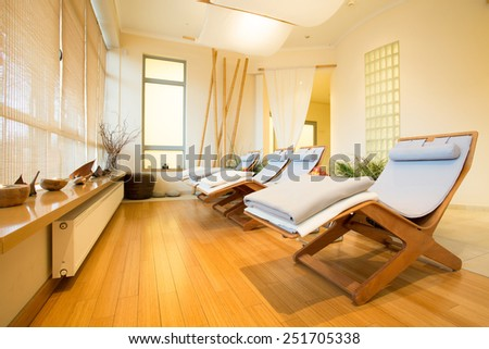 Small luxury room with wooden floor at modern health resort - stock photo