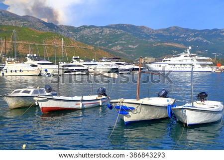 Small Mediterranean harbor with various types of boats, Budva, Montenegro