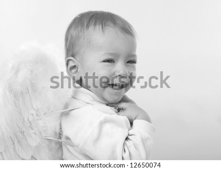 small merry boy dressed as angel, black and white