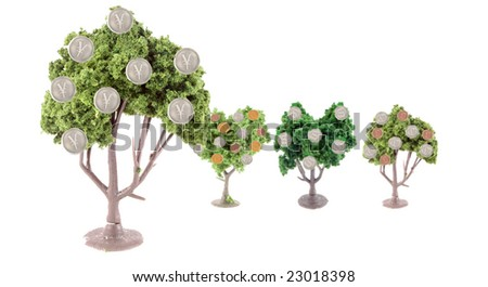 small miniature forest growing copper and silver dollars, yen, euros and British pound coins ... Japanese yen tree is in front showing strength in currency exchange - stock photo