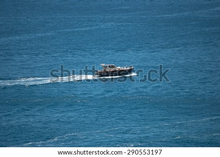 Small motor boat stops at the port