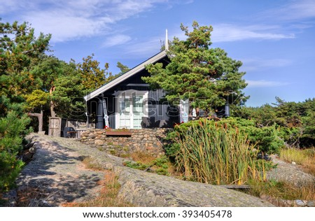 Small mountain house/villa built on the rocks in Norway - stock photo
