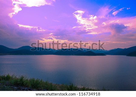 small mountain lake in the evening - stock photo