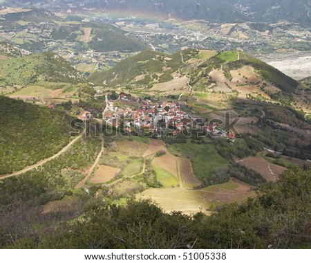 small mountain village & rainbow