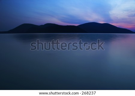 Small mountains and water reflection