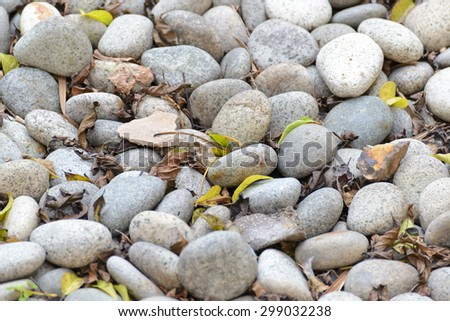 Small naturally polished white rock pebbles background - stock photo