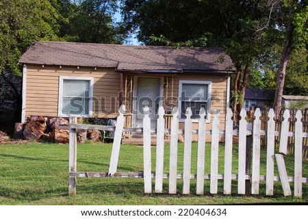 Small neglected house with a lawn - stock photo
