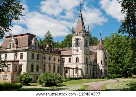 Small old castle surrounded with trees (Latvia)