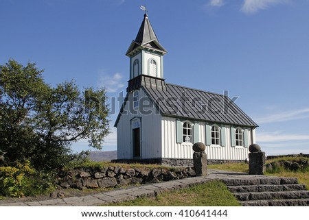Small old church Pingvallkirkja on sunny day in Thingvellir, Iceland - stock photo