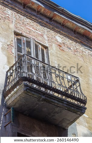 small old house with balconies and doors damaged - stock photo