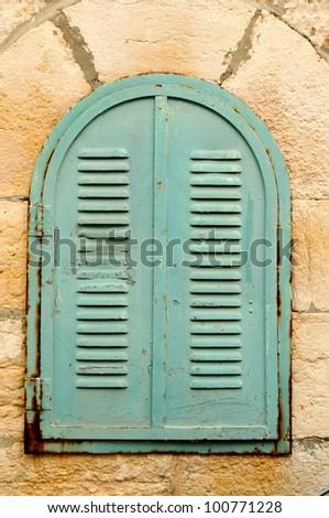 small old metal window - stock photo