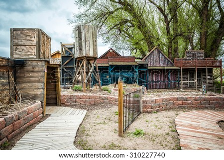 Small old town with wooden buildings and entrance to a mine - stock photo