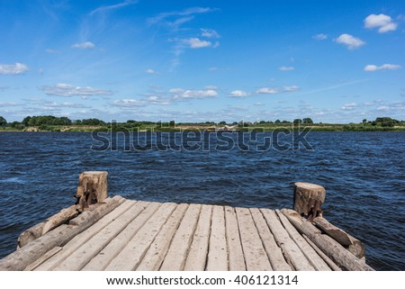 Small old wooden dock on the Oka river, Russia.   - stock photo