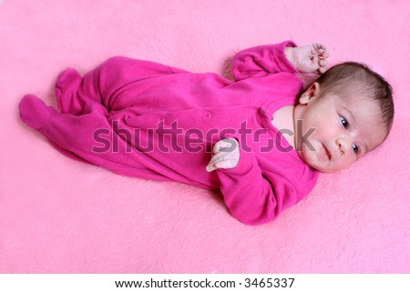 small one week old newborn baby on a pink background - stock photo