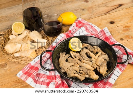 Small pan with freshly cooked mushrooms, a healthy tapa - stock photo