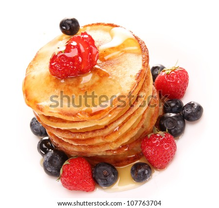 Small pancakes topped with honey - stock photo