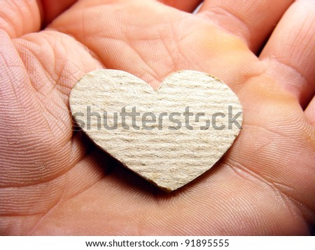 Small paper heart on a hand