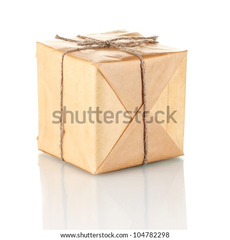 Small parcel wrapped in brown paper tied with twine isolated on white - stock photo