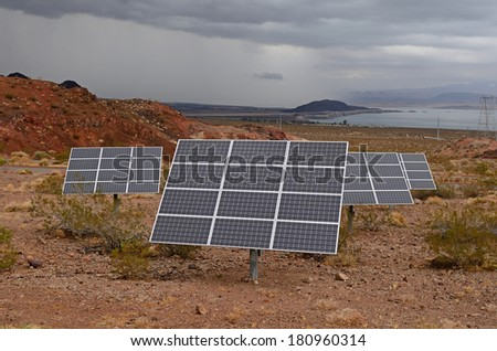 Small photovoltaic cell solar panel array set up for a state visitor center in Nevada during a large rain storm - stock photo