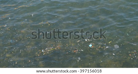 Small piece of broken down garbage in the ocean - stock photo