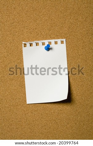 Small piece of paper pinned to a cork board
