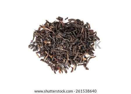 Small pile of big leaf Chinese black tea isolated on white background, top view, selective focus