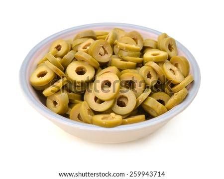 Small pile of sliced green olives isolated in bowl on the white background  - stock photo