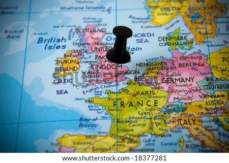 Small pin pointing on London (UK) in a map of Europe - stock photo