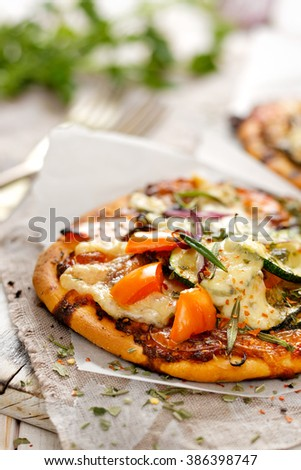 Small pizza with addition of vegetables