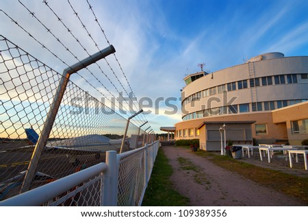 Small plane airport security fence and traffic control building in Helsinki, Finland