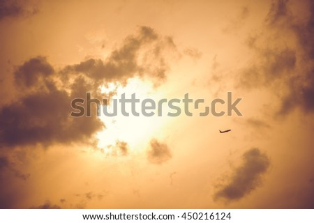 small plane taking off evening sky - stock photo