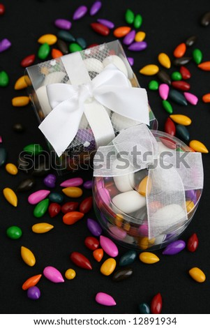Small plastic Wedding favor boxes with mints and sweets - stock photo