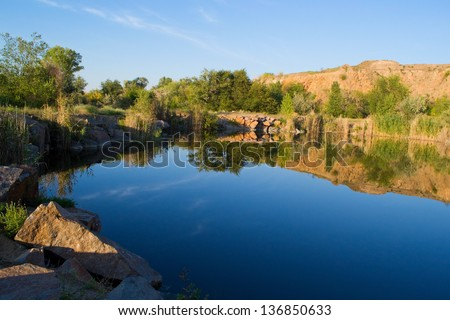 Small pond on a summer evening