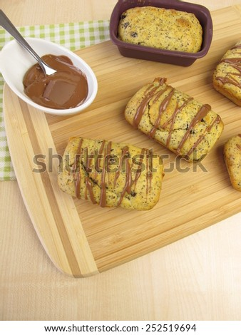 Small poppy seed cakes with chocolate coverture - stock photo